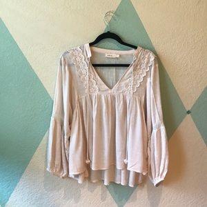 white, loose blouse.